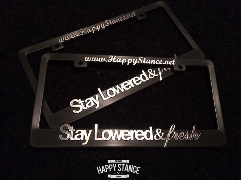 "Image of ""STAY LOWERED & FRESH"" LICENSE PLATE FRAME (CHROME POLISH)"