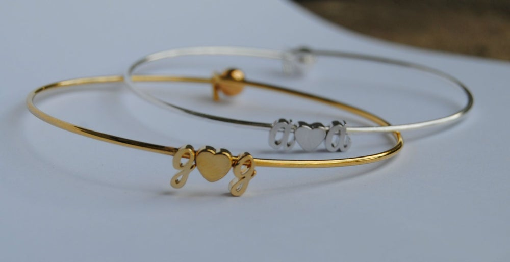 Image of Tiny Cursive Initial Love Bangle