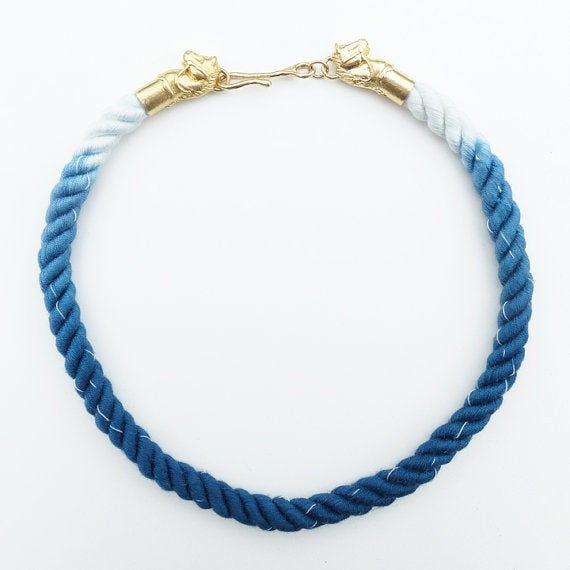 Image of Brass Horse Necklace with Blue and White Cotton Cord