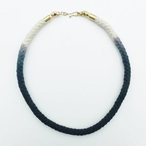 Image of Brass Dog Necklace with Black and White Cord