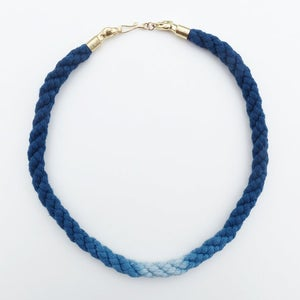 Image of Brass Dog Necklace with Blue and White Cotton Cord