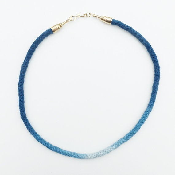 Image of Brass Pawn Necklace with Blue and White Cord