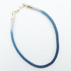 Image of Brass Swan Necklace with Blue and White Cord
