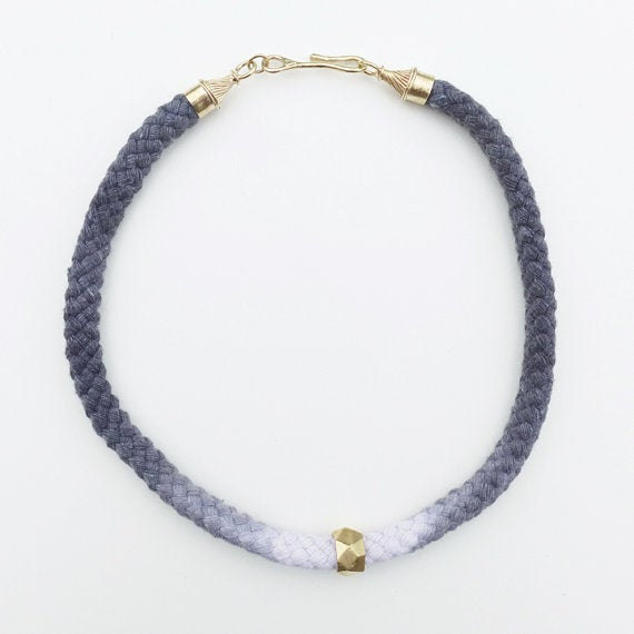 Image of Brass Swirl Necklace with Gray and White Cord and Brass Bead