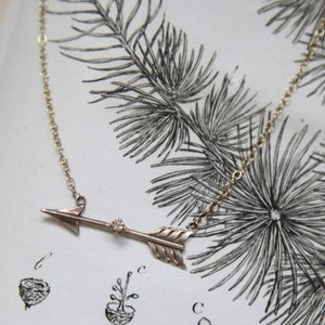 Image of gold arrow and champagne diamond necklace