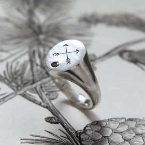 Image of large arrow signet ring with diamond
