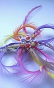 Image of Catherine Wheel Frou Frou Fascinator in pretty pastel colours