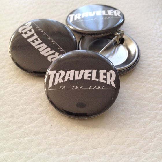 Image of Traveler button.