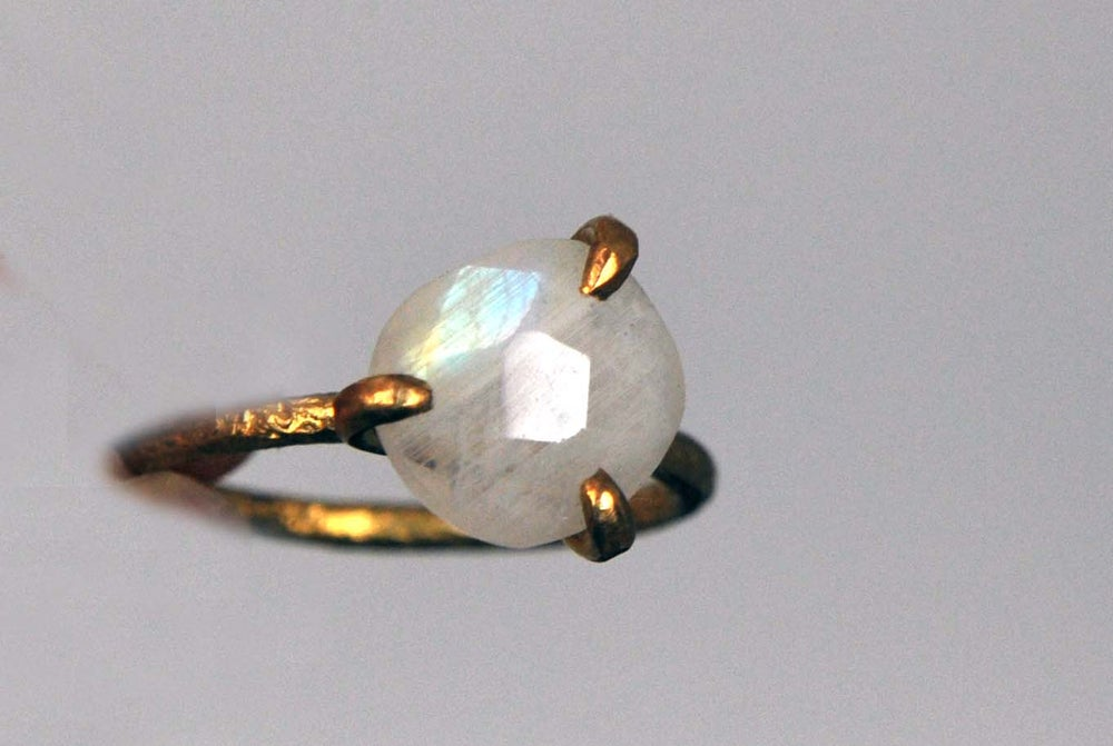 Image of Clawring fancy cut in brass with a moonstone