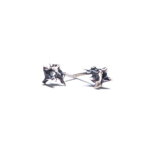 Image of tiny vertebrae stud earring (E20)
