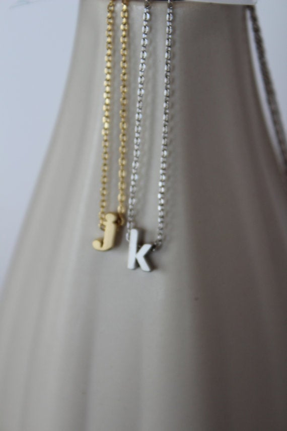 Image of lower case initial necklace