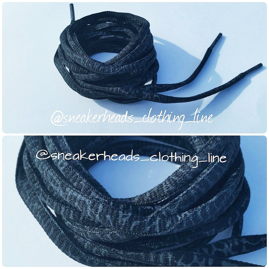 """Image of Exclusive """"BHM/Elephant Print"""" Oval Laces (Black)"""