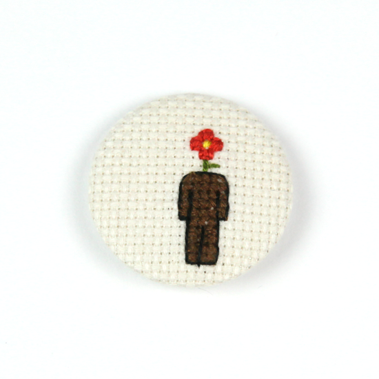 Image of Flowerman Cross-Stitched Button