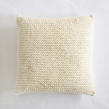 Image of cream knit cushion cover