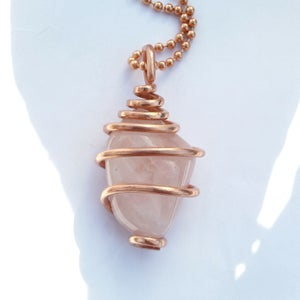 Image of Copper Wrapped Tumbled Rose Quartz