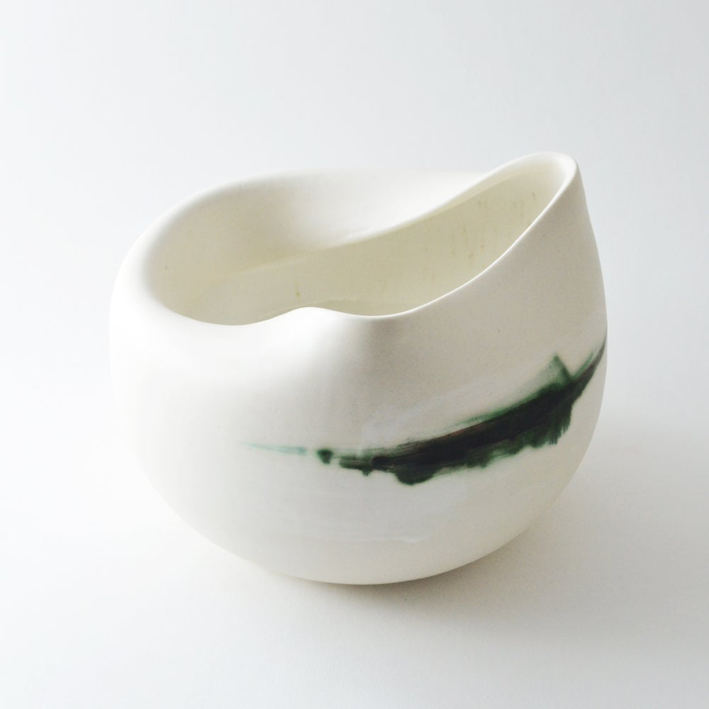 Image of altered porcelain vessel