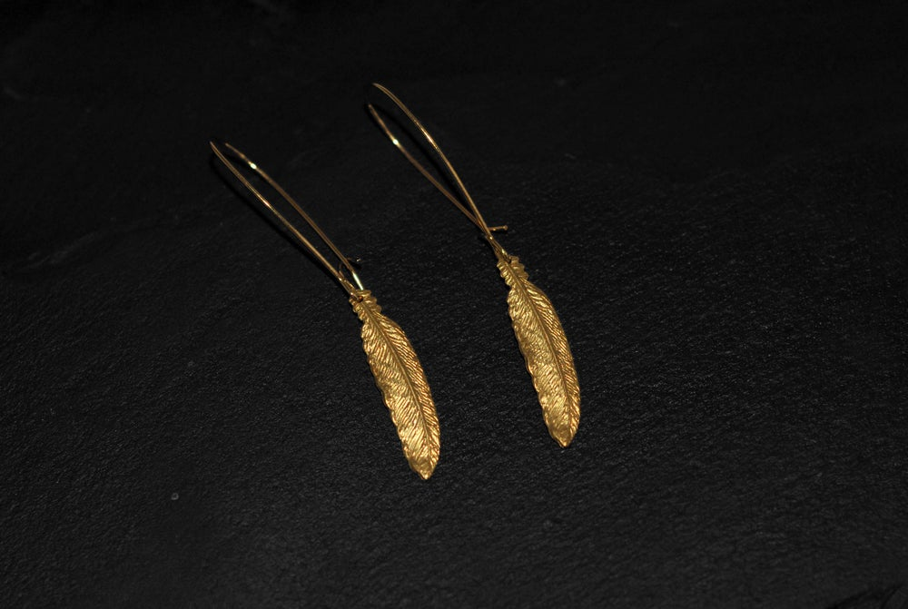 Image of Pair of small feather earrings in brass