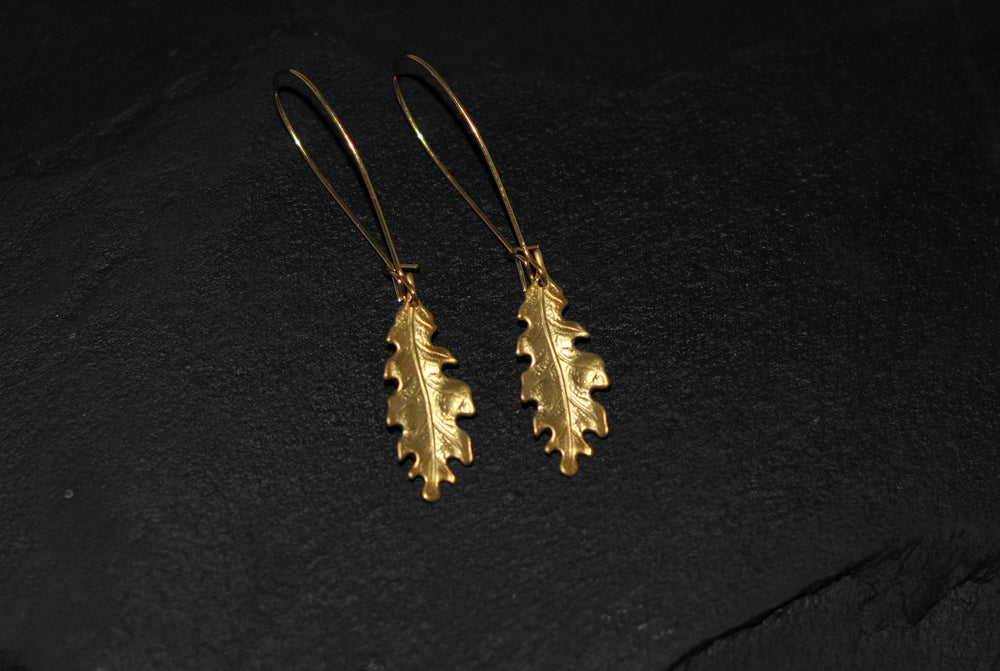 Image of Pair of small oak leaf earrings in brass