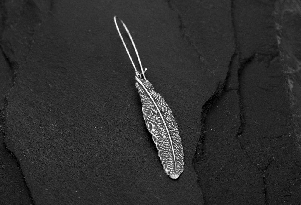 Image of Medium feather earring in silver plated brass
