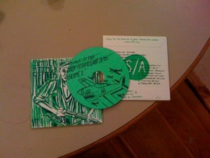 """Image of """"Drop Records, Not Bombs"""" Volume 1"""