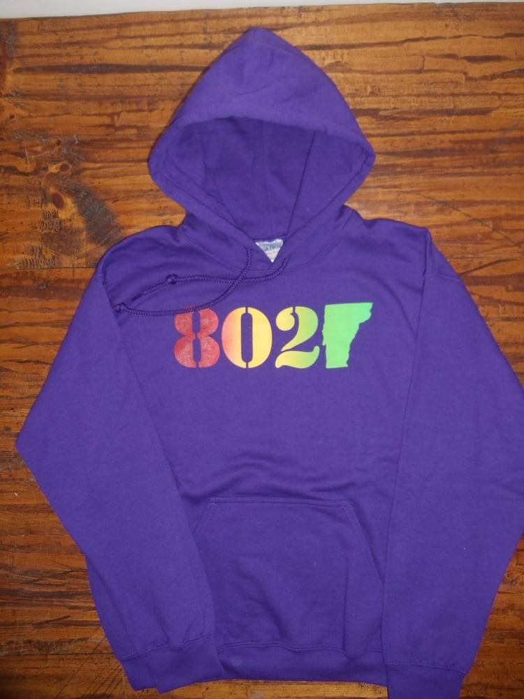 Image of 802 Classic Vermont Hooded Sweatshirt - Red, orange, yellow, green (Rasta) 802 logo on Purple Hoodie