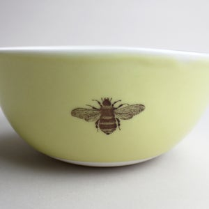Image of rustic bowl with bumblebee, mustard