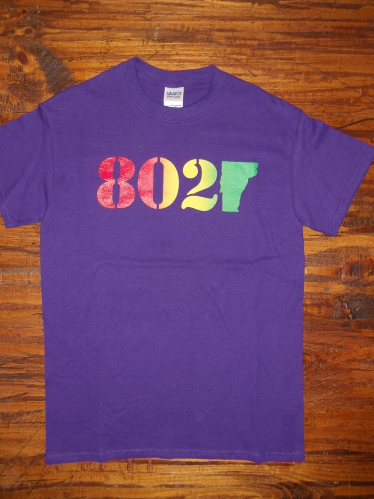 Image of 802 Classic Vermont T-Shirt - 802 on a Purple Shirt - Toddler, Kids Youth & Adult (Men's & Women's)