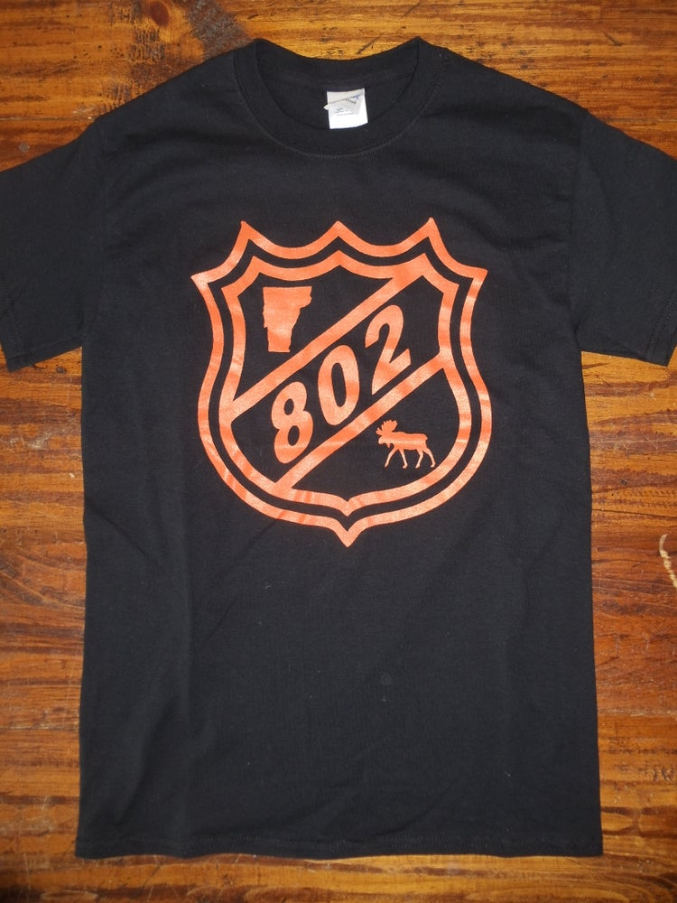 Image of 802 NHL slapstick Tee
