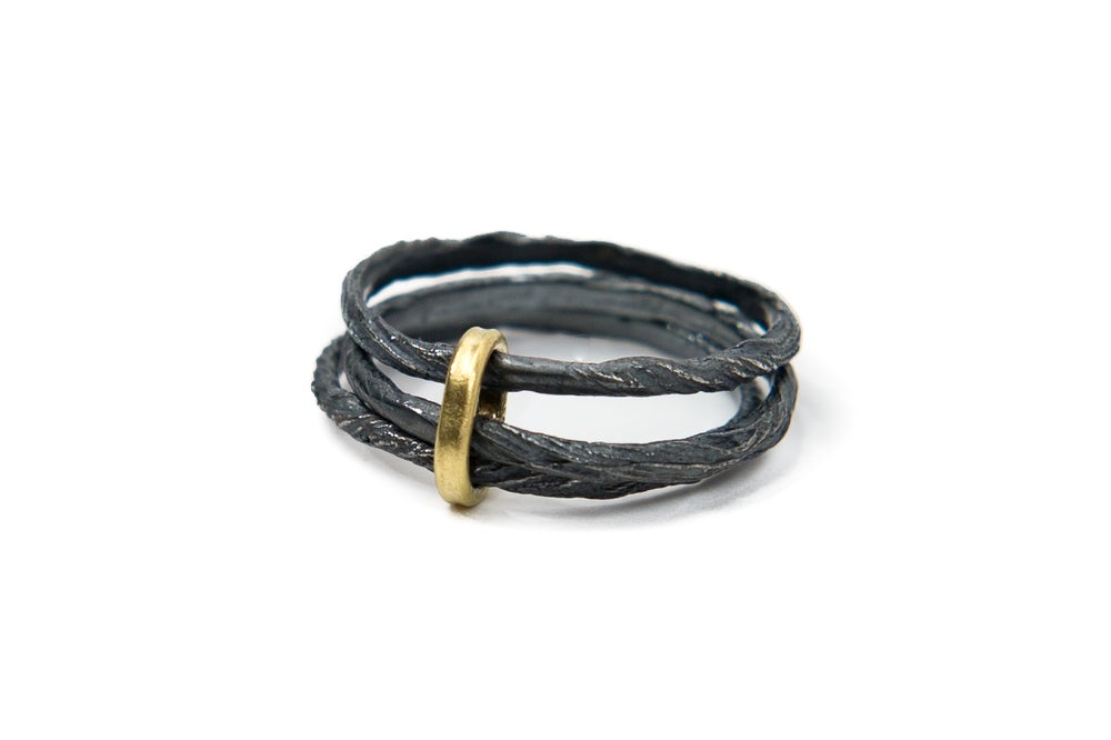 Image of oxidised triple thread ring