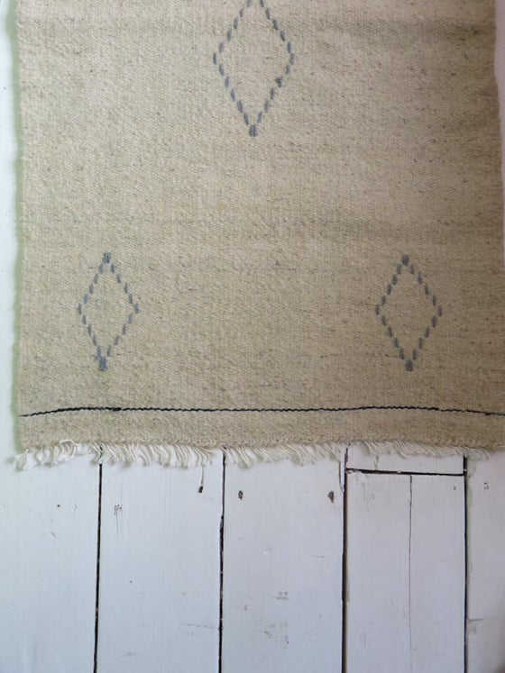 Image of Simple hand-woven bedside rugs