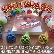 Image of Snotgrass signed with Swamp Bogger toy