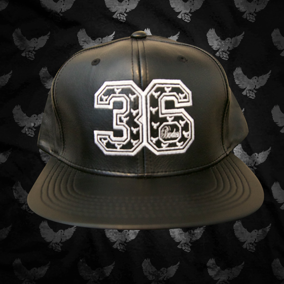 Image of Black/White 36 Leather Snapback