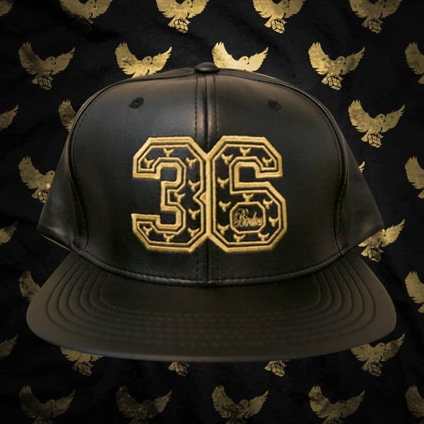 Image of Black/Gold Leather 36 Snapback