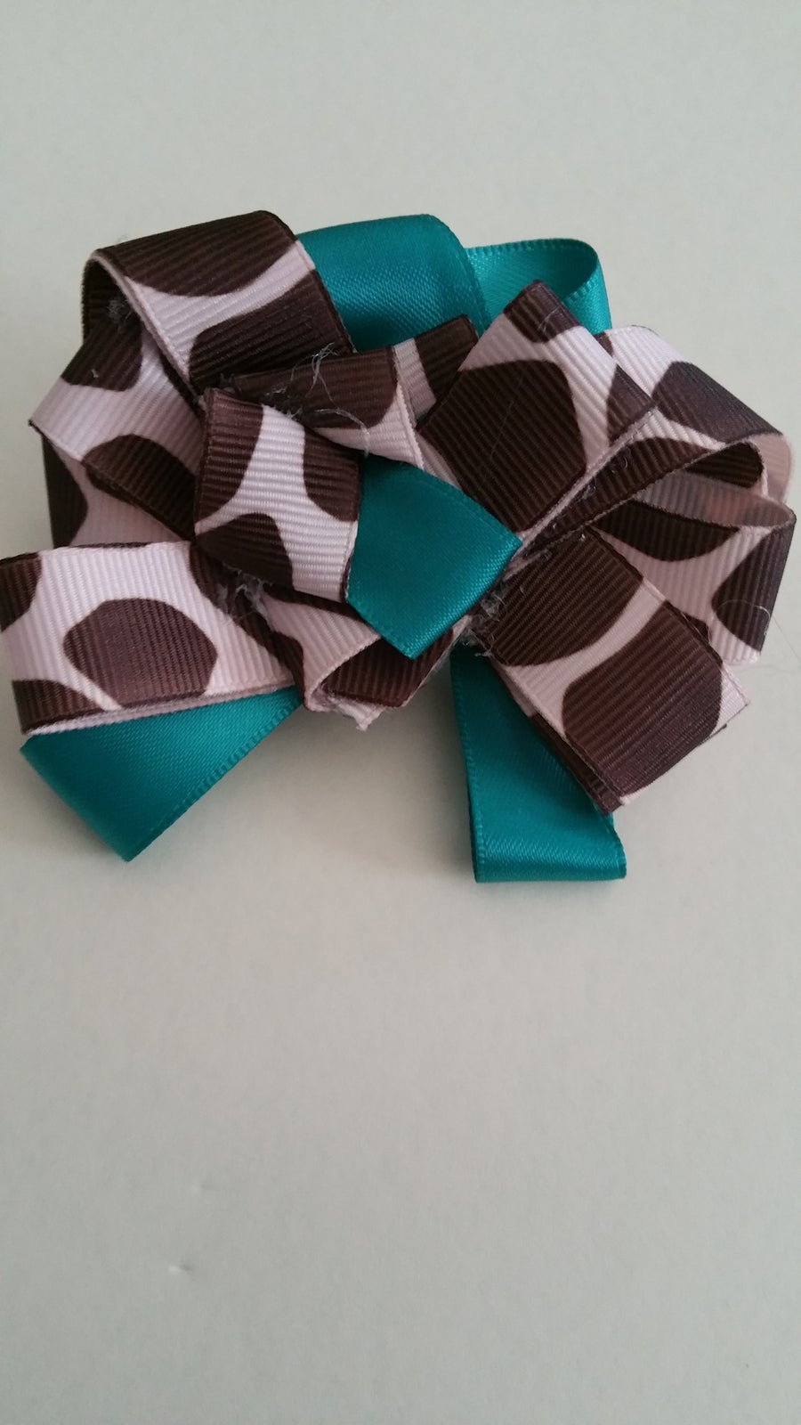Image of Turquoise, brown,and khaki Bow