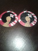 Image of afrolady with flower earrings