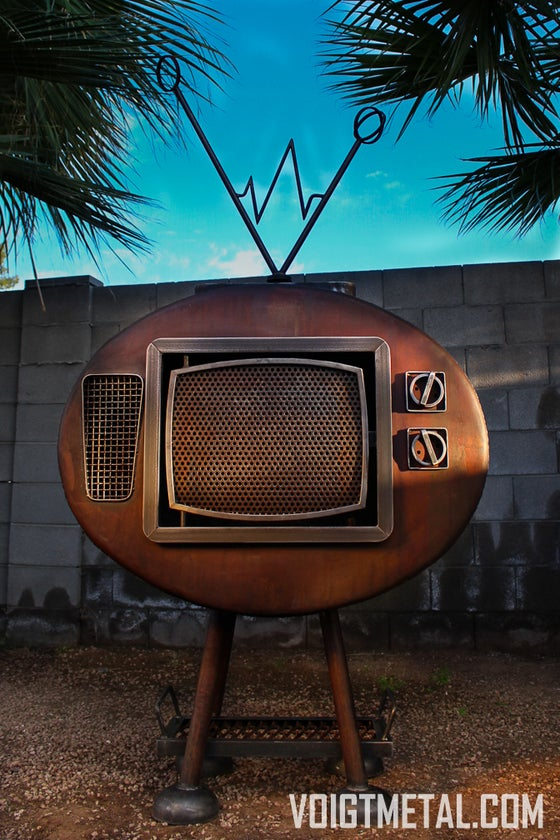 """Image of """"Nothings ever on"""" Voigt Metal T.V.-Outdoor wood burning fireplace"""