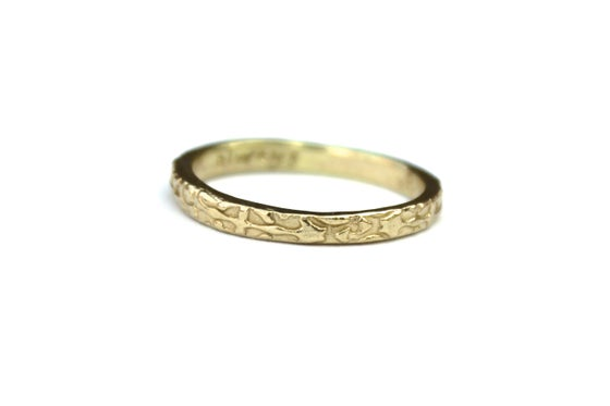 Image of thin 14k yellow gold wedding band . R2
