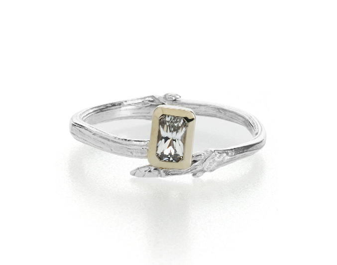 Image of emerald cut moissanite twig engagement ring