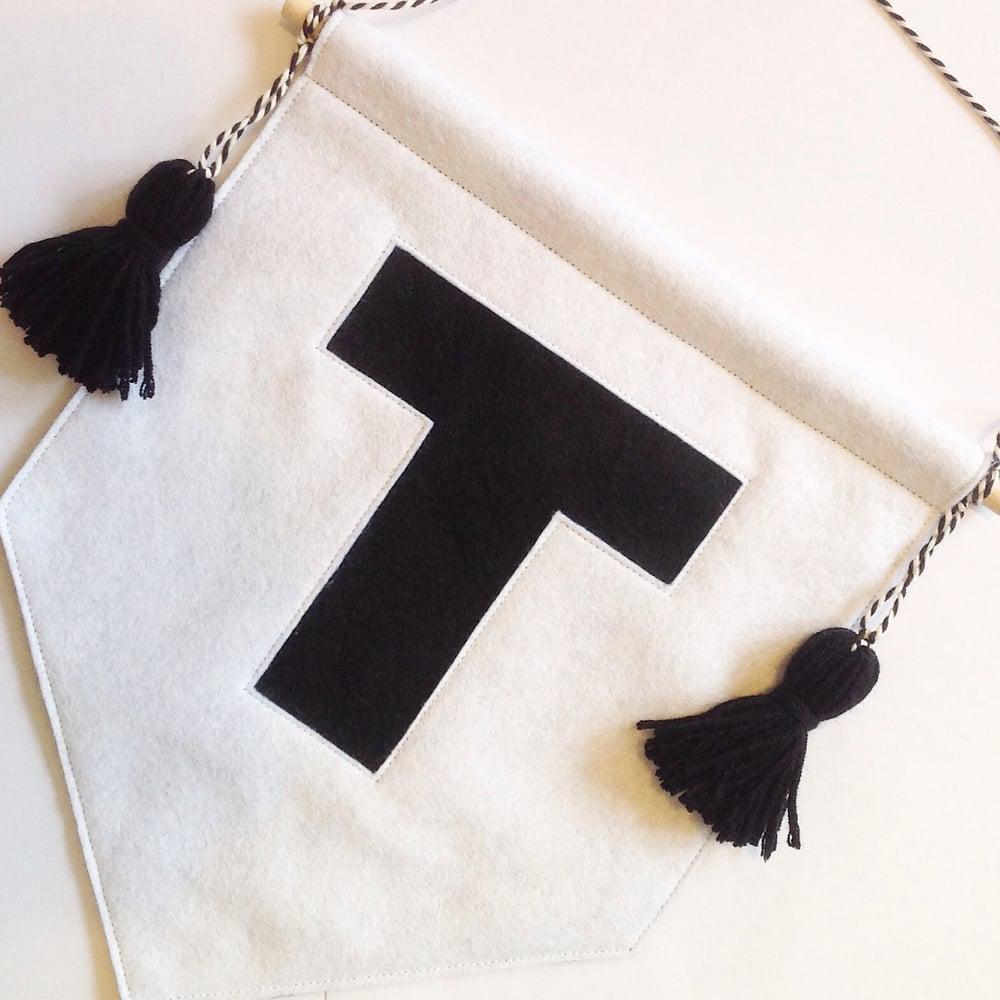 Image of Tassel Initial Banner