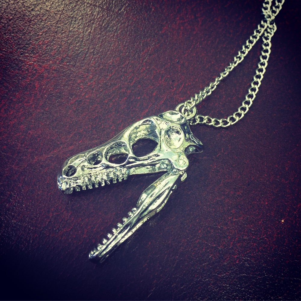 Image of Dinosaurs head necklace
