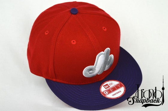 Image of MONTREAL EXPOS RED/PUR NEW ERA SNAPBACK CAP