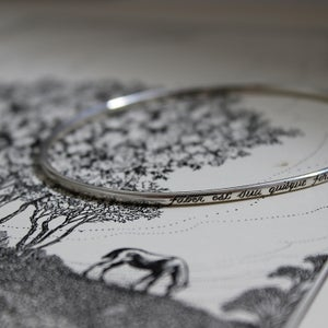 Image of latin engraved bangle