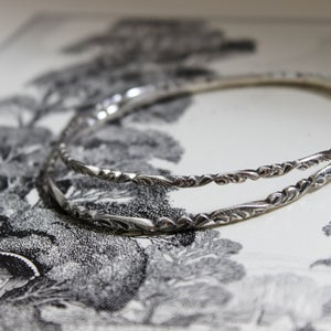 Image of floral carved bangle