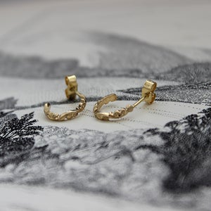 Image of floral carved hoop earrings