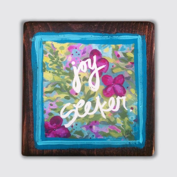 Image of joy seeker print on wood