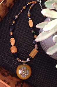 Image of Antique African amber pendant with silver and copper set