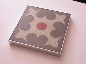 Image of Heart grey, cream and red Barcelona rescued cement tile trivet