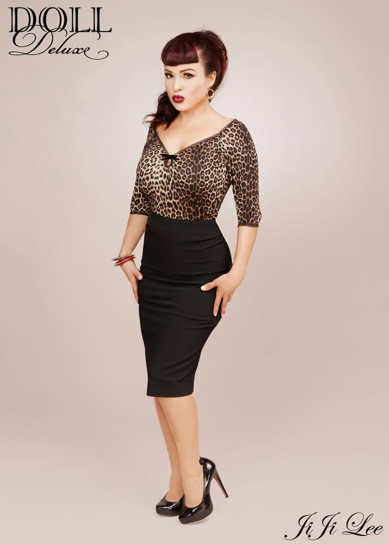 Image of Leopard print keyhole top-3/4 sleeve