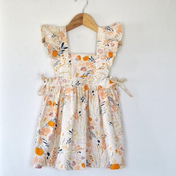 Image of the claudia pinafore dress
