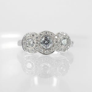 Image of Three stone diamond cluster engagement ring